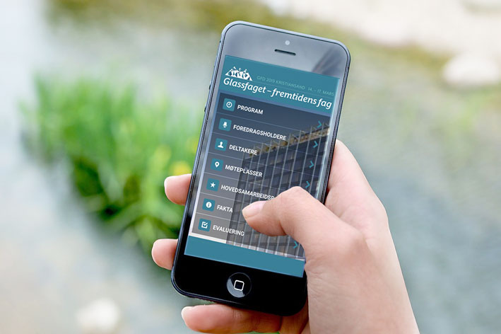 Foto av mobiltelefon med app